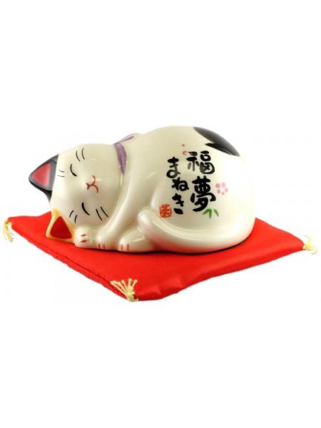 Maneki Neko gatto porta fortuna invito al buon auspicio